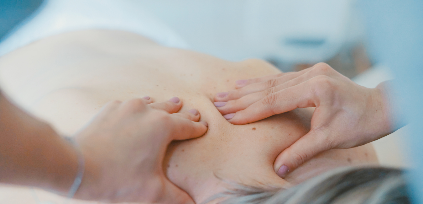 hands massage the back of a neck with medium pressure